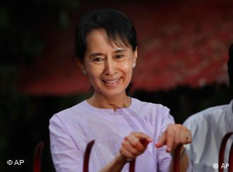 Aung San Suu Kyi addresses her supporters after her release from house arrest in Yangon