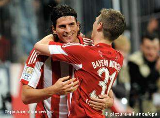 Gomez and a teammate hug after a goal