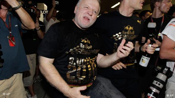 Norbert Vettel of Germany, father of Red Bull driver Sebastian Vettel, plays the air guitar after his son became Formula One World Champion 2010 at the Emirates Formula One Grand Prix at the Yas Marina racetrack in Abu Dhabi, United Arab Emirates, Sunday, Nov. 14, 2010. (AP Photo/Gero Breloer)