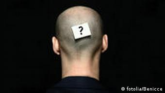 A shaved male head with a question mark