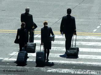People walking with suitcases
