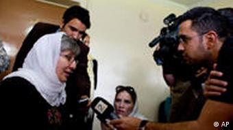 Afghan human rights advocate Sima Samar talks to media before the announcement of this year's Nobel Peace prize, Friday, Oct. 8, 2010 in Kabul, Afghanistan.