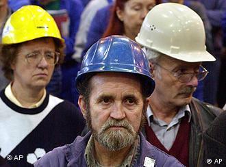 Steelworkers wearing helmets