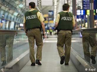 Two armed policemen in an airport
