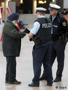 A security check by police at Hamburg Airport, the two police officers are asking a Sikh man for his documents. (Photo: Axel Heimken/dapd)
