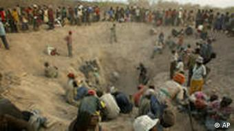 Artisanal miners dig for rough diamonds in the Marange Fields in Zimbabwe.