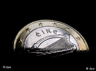 Part of an Irish one-euro coin, visible against a blank backdrop