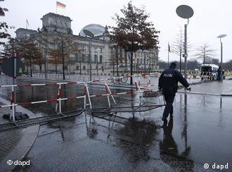 A police officer close to a security fence in front of the Reichstag building,