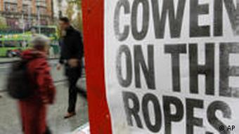 A newspaper headline in central Dublin, Ireland, reads: COWEN ON THE ROPES
