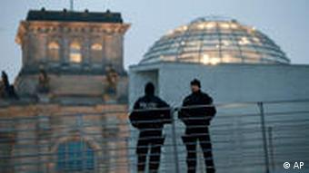 Police officers stand guard near the Reichstag building