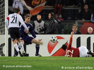 Marco Borriello scores against Munich's Philipp Lahm and goalkeeper Thomas Kraft