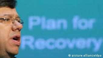 Irish Prime Minister Brian Cowen's face in front of a sign with the phrase Plan for Recovery