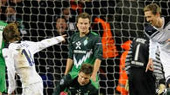 Tottenham's Luca Modric, second left, celebrates scoring against Werder Bremen with his teammate Peter Crouch, second right, during the Champions League Group A soccer match between Tottenham Hotspur and Werder Bremen at White Hart Lane stadium in London, Wednesday, Nov. 24, 2010.