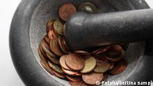 Mörser mit Inhalt Geld