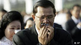 Cambodian Prime Minister Hun Sen and his wife Bun Rany fought back tears