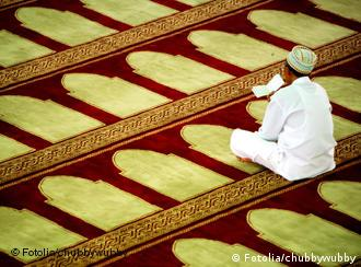 Man sitting on carpet in mosque