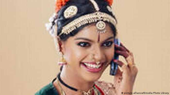 Bharatnatyam dancer talking on mobile phone