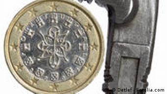 A Portuguese one-euro coin held in a small vice