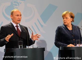 Russian PM Putin and German Chancellor Merkel
