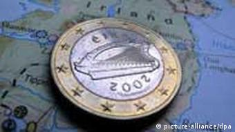 An Irish euro coin on a map of Ireland