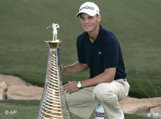 Germany's Martin Kaymer poses with the European Tour money title trophy