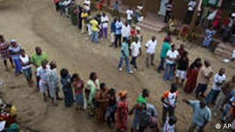 Voters wait in lines to vote at polling stations in Groupe Scolaire Saint Jeanne in the Abobo neighborhood of Abidjan, Ivory Coast, Sunday, Nov. 28, 2010. Ivorians went to the polls Sunday in a long-overdue presidential election that many hope will reunite the country eight years after a civil war divided it in two. Voters are choosing between president Laurent Gbagbo and the man he accuses of being behind the rebellion that sought to topple him, Alassane Ouattara. (AP Photo/Rebecca Blackwell)
