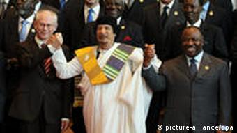 Libyan leader Moammar Gadhafi with Herman van Rompuy, President of the European Council, and Chairperson of the African Union, Gabon's President Ali Bongo, at an AU/EU summit in Tripoli in November 2010