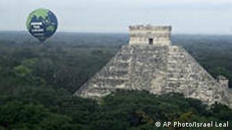 An aerostatics balloon of the environmental group Greenpeace is seen next to the Mayan ruins of Chichen Itza in Mexico