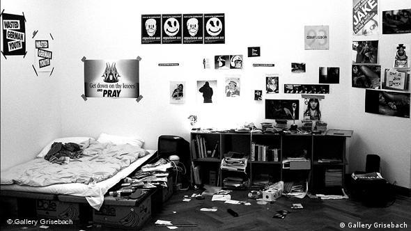 Untidy bedroom with posters reading Wasted German Youth