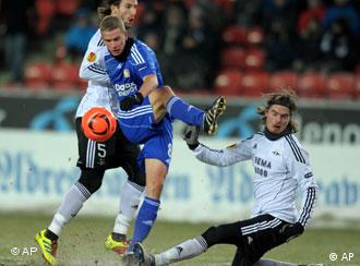 Leverkusen's Lars Bender (middle) and Trondheim's Mattias Bjarsmyr (left) and Mikael Lustig vie for the ball