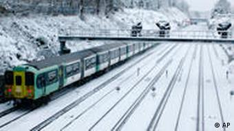 A British train on snow-covered tracks in London
