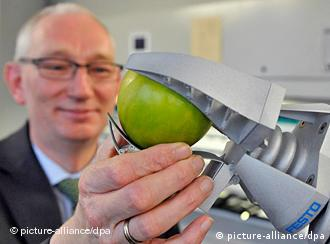 Research leader Peter Post with the grappler holding an apple