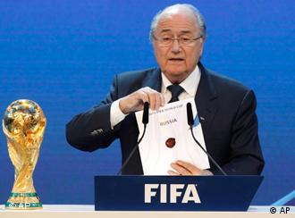 FIFA President Blatter holds up a card that read Russia