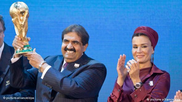 HH Sheikh Hamad bin Khalifa Al-Thani (l), The Emir of the state of Qatar, holds the World Cup