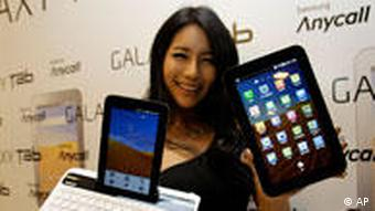 A models introduces Samsung Electronics' Galaxy Tab, featuring the 7-inch touch screen, during its unveiling ceremony in Seoul, South Korea, Thursday, Nov. 4, 2010. The price of the Galaxy Tab, which runs on Android 2.2, hasn't been unveiled and its goes on sale in the domestic market from next week. (AP Photo/ Lee Jin-man)