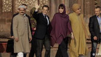 Sarkozy and his wife Carla Bruni during their visit to a Sufi shrine at Fatehpur Sikri