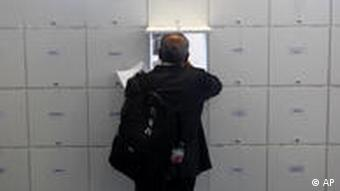 A conference participant checks a mailbox at the United Nations Climate Change Conference in Cancun