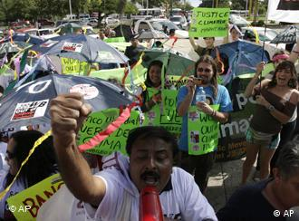 Activists demonstrate in the streets of Cancun over the climate conference