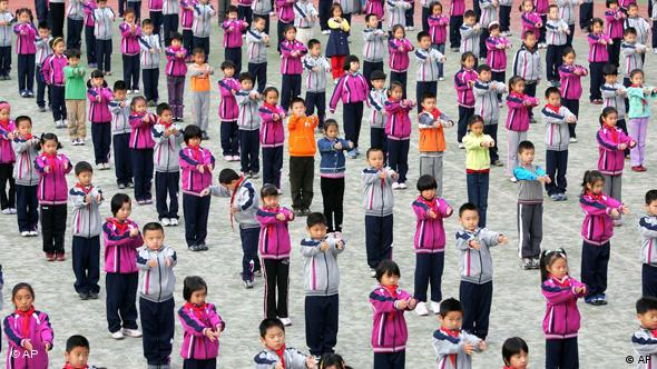 Children exercise during a physical education period at the Huajiadi Experimental Primary School in Beijing Wednesday Oct. 25, 2006. Chinese authorities are encouraging schools to adopt sports and educational programs that tie into the Olympics in an effort to build awareness of Olympic ideals ahead of the 2008 Beijing Olympic Games. (AP Photo/Greg Baker)