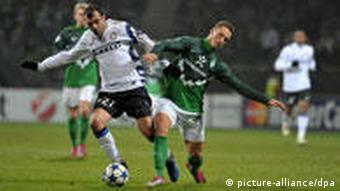 Bremen's Marko Arnautovic and Goran Pandev (L) of Inter Milan fight for the ball