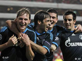 Schalke's Benedikt Howedes, Raul Gonzalez, Kyriakos Papadopoulos, and Jose Manuel Jurado, from left, celebrate after scoring their second goal against Benfica during their Champions League group B soccer match Tuesday, Dec. 7 2010, at Benfica's Luz stadium in Lisbon.