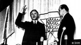 Konrad Adenauer takes his oath of office on Sept. 20, 1949 from President Erich Koehler