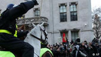 Students facing policemen on horseback