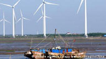 --FILE--View of wind turbines at a wind farm in Rudong, east Chinas Jiangsu province, 29 May 2010. Chinas wind power has expanded rapidly in recent years, almost doubling in size every 12 months since 2005. According to the Global Wind Energy Council, China had wind power capacity of 25.1 gigawatts by the end of 2009. The Clean Development Mechanism (CDM), the worlds leading carbon market and an important tool for the promotion of carbon cuts, climate protection and sustainable development, has played an important role in this growth. As of the end of 2009, 32% of Chinas wind power capacity was registered as CDM projects, with accumulated carbon cuts by 2012 predicted to be 82.5 million tonnes. As a result, Chinas wind power development has been held up as a model of successful CDM application, and these projects have become popular low-risk options in international carbon markets.