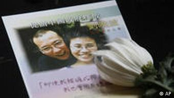 A flower is placed near a picture of Liu Xiaobo in Hong Kong on Friday