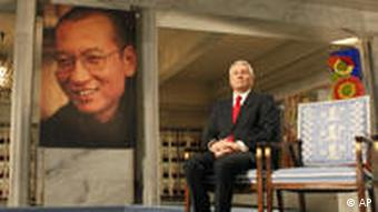 nobel committee president next to empty chair of liu xiaobo