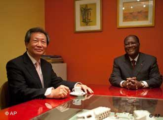Opposition leader Alassane Ouattara, right, with United Nations's envoy to Ivory Coast, Choi Young-jin, left, prior to a meeting at the Golf hotel in Abidjan, Ivory Coast, Thursday, Dec. 9, 2010. The U.N. Security Council is ready to take targeted measures against people who try to upset the peace process or violate human rights in Ivory Coast. The international body is also calling on all sides to respect the electoral victory of opposition presidential candidate Alassane Ouattara. (AP Photo/Thibault Camus)