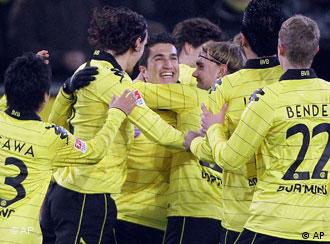 Dortmund's Nuri Sahin of Turkey, third frm left, celebrates with teammates
