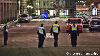 Swedish police guard a street following a series of detonations on Saturday