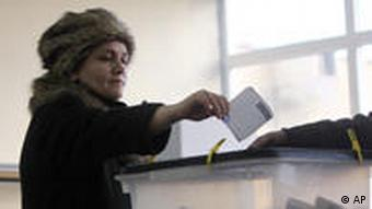 A Kosovo Albanian woman casts her ballot in the elections.